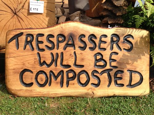 Trespass sign -  - carved by my wife Michele.