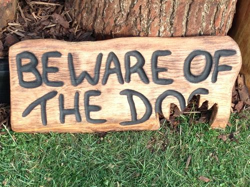 Beware of the Dog sign  - carved by my wife Michele.