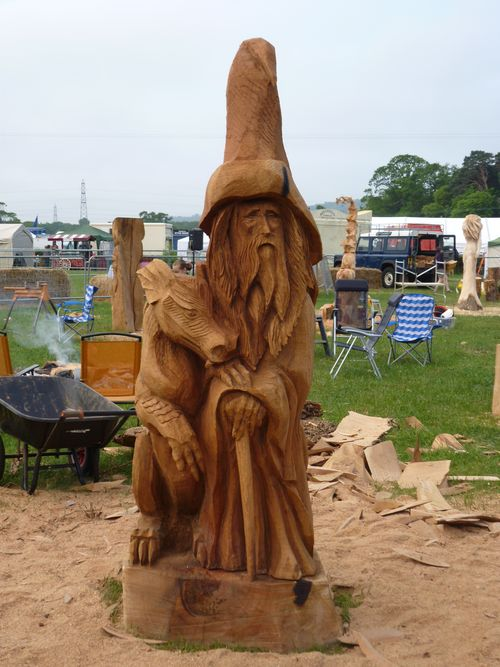 D chainsaw sculptures event pieces wizard and his dragon